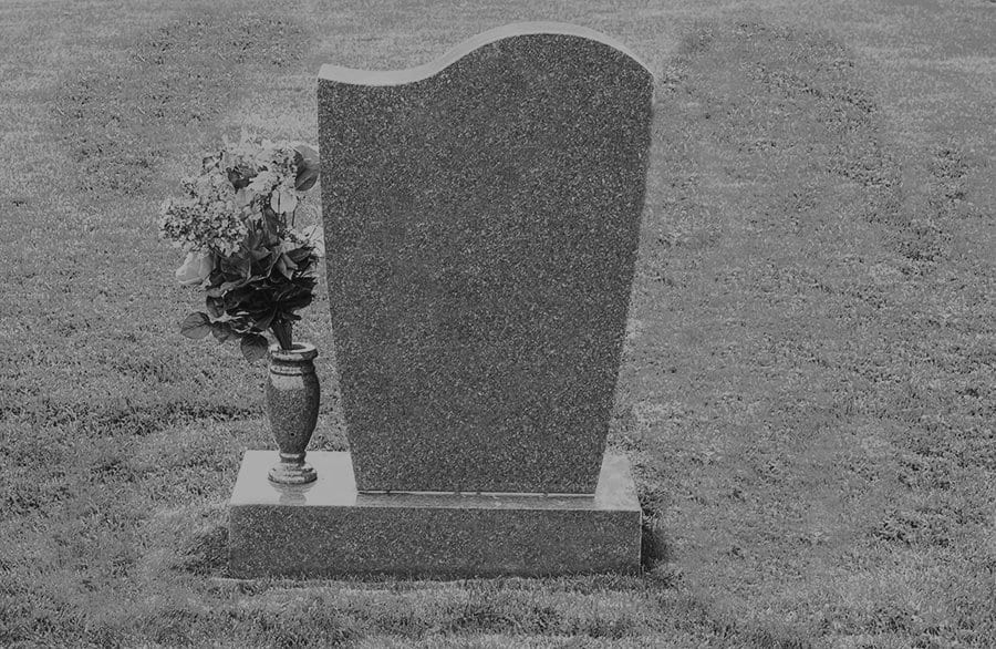 granite headstone in grass
