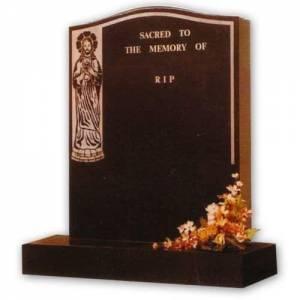 granite headstone with jesus decoration