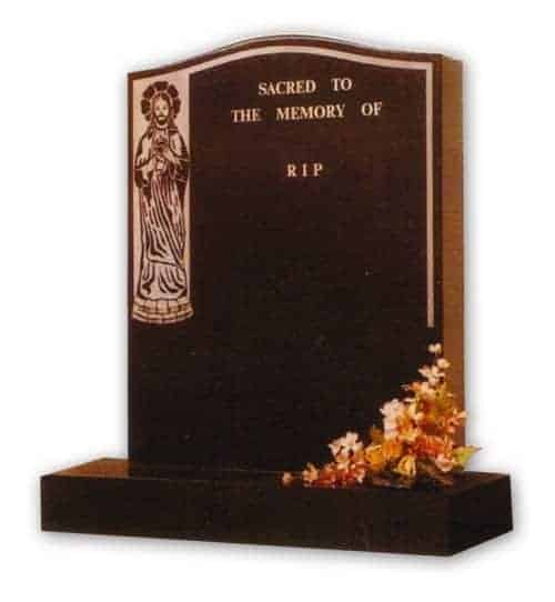 granite headstone with jesus decoration