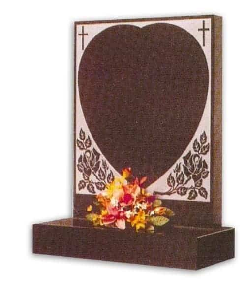 granite headstone with heart decoration
