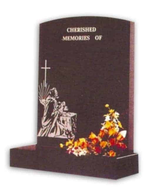 granite headstone with cross and praying person engraving