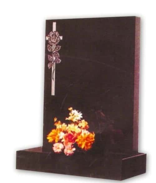 granite headstone with flower and cross engraving