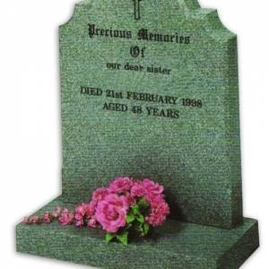 granite headstone with cross and engraving