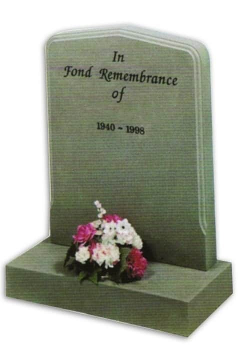 granite headstone with inscription and flowers