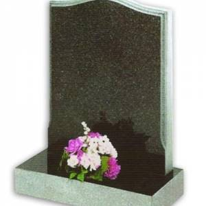 grey granite headstone with flowers