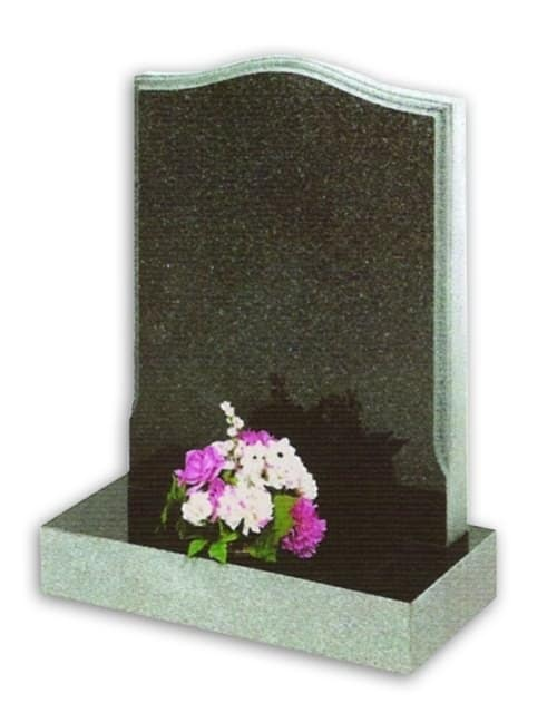 grey granite headstone with flowers