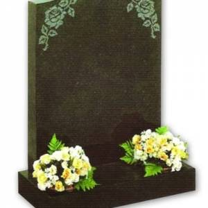 granite headstone with white and yellow flowers