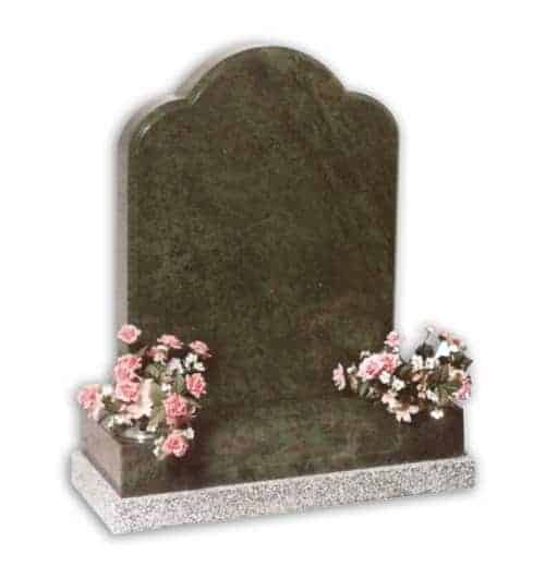 green headstone with flowers