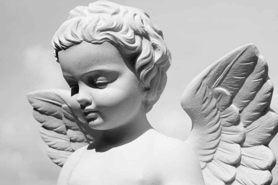 statue of baby with wings