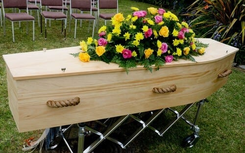 coffin outside with flowers