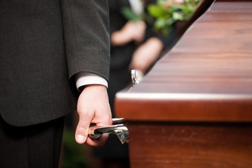 man holding coffin